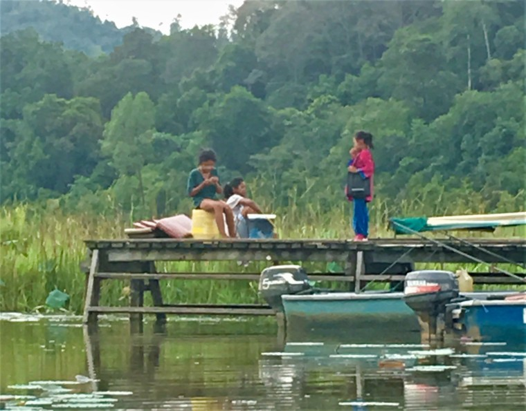 children-from-kampung-cendahan-play-at-the-village-jetty
