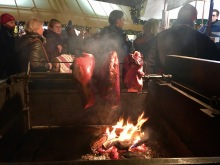 Old Prague Ham roasting over an open fire