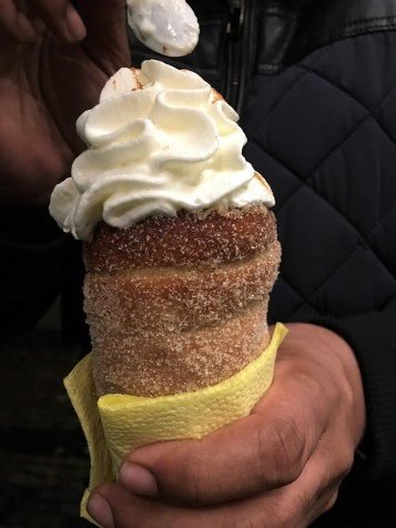 Trdelnik with warm apple filling and cream on top
